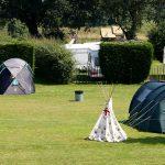 tents-near-touring-van-caravan-camping-park